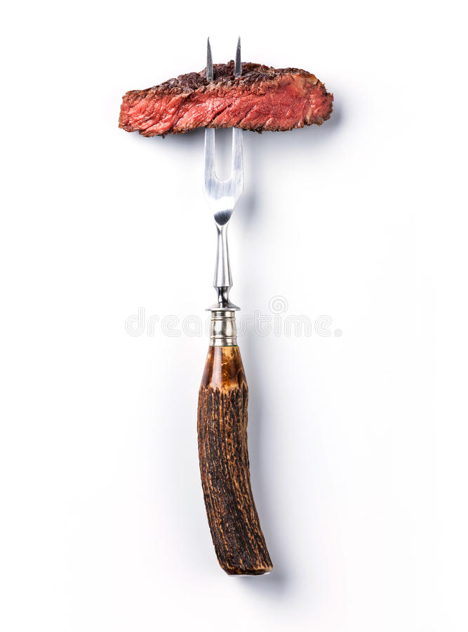 Sliced steak ribeye on meat fork royalty free stock photos