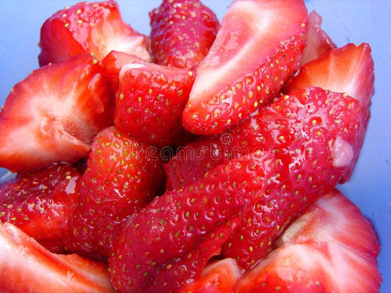 Sliced strawberry royalty free stock images