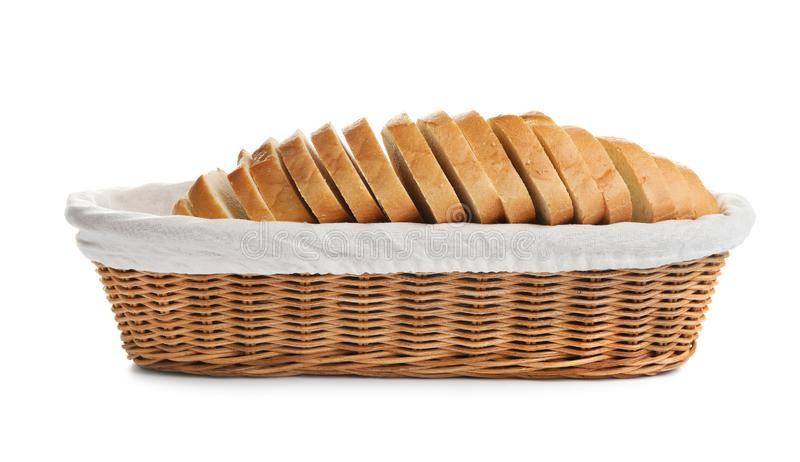 Sliced tasty fresh bread in wicker basket on background. Sliced tasty fresh bread in wicker basket on white background royalty free stock image