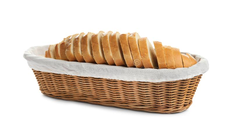 Sliced tasty fresh bread in wicker basket. On white background royalty free stock image