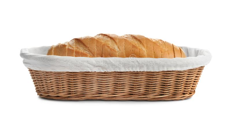 Sliced tasty fresh bread in wicker basket. On white background stock photos