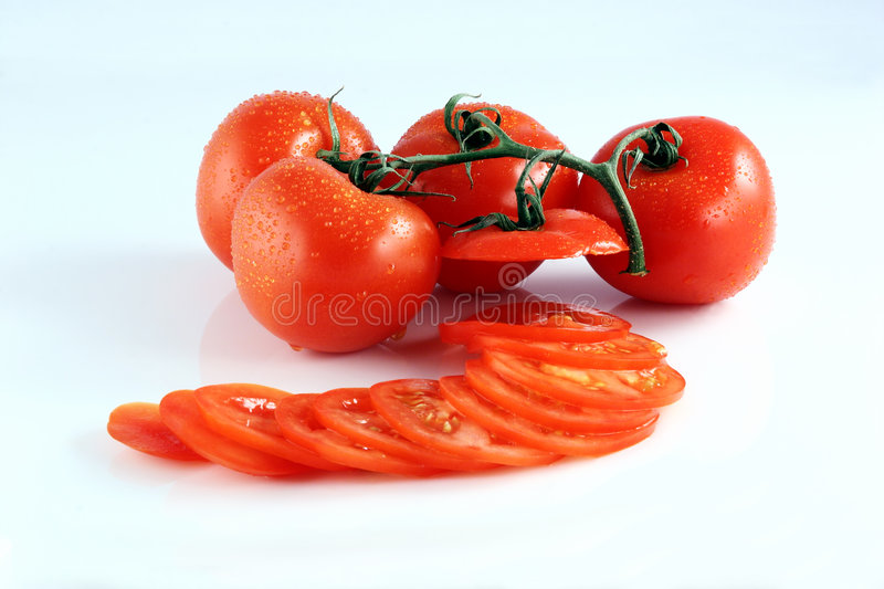Sliced Tomatoes On A Vine royalty free stock photography