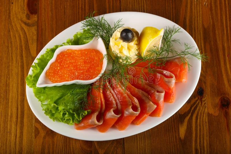 Sliced trout and red caviar royalty free stock images