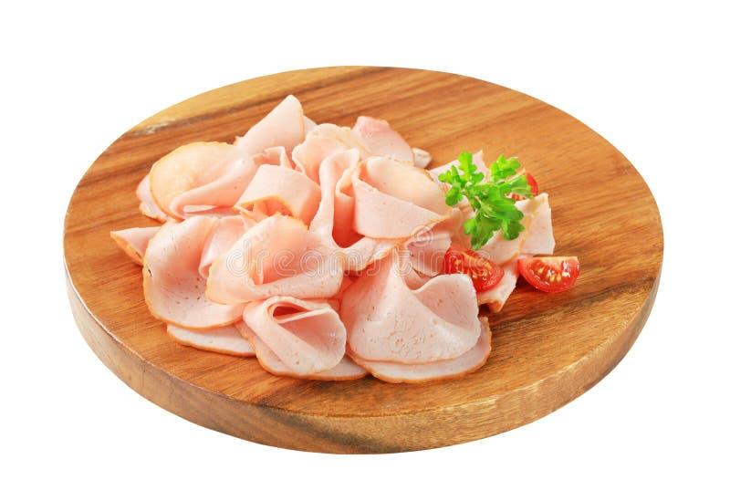 Sliced turkey ham stock images