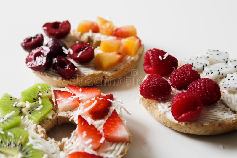 Sliced Variety of Fruits on Round Baked Bread stock photos