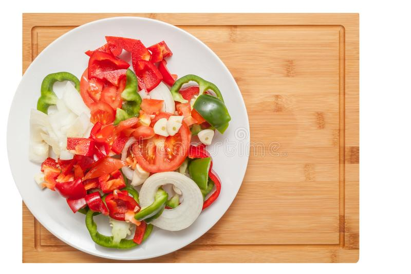 Sliced vegetables on wooden table. Photo of colorful healthy vegetables - pepper, onion and tomato stock photos