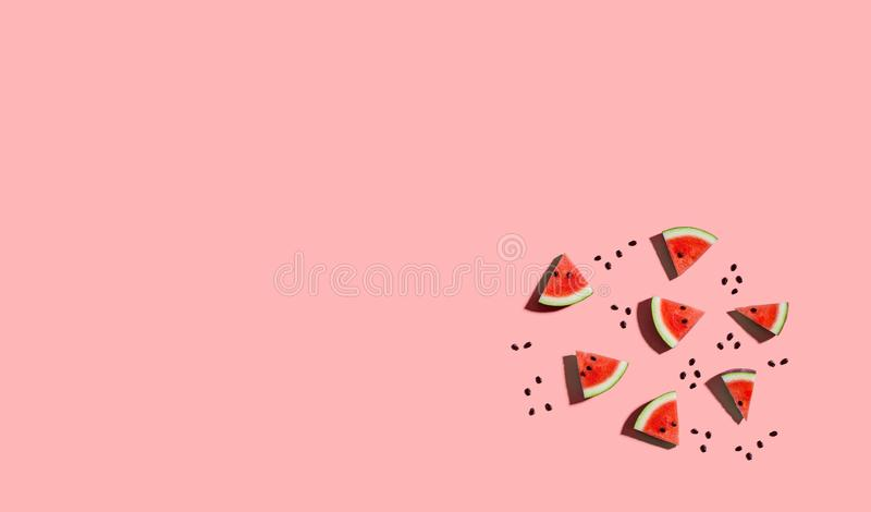 Sliced watermelons arranged. On a pink background royalty free illustration