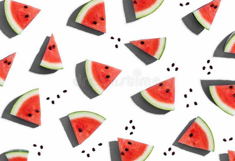 Sliced watermelons arranged. On a white background royalty free illustration