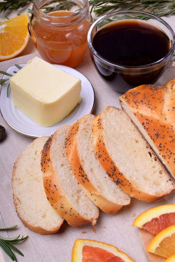 Sliced wheat bread surrounded by butter and orange stock photos