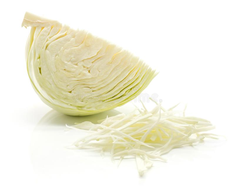 White cabbage on white. Sliced white cabbage quarter and chopped stack on white background royalty free stock photos