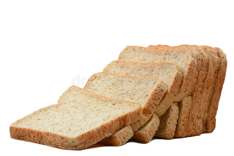 Sliced whole wheat bread isolated on white royalty free stock photography