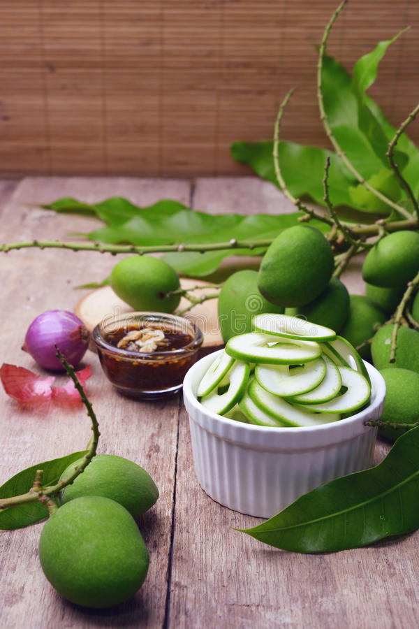 Download Sliced Young Mangoes With Sweetened Fish Sauce. Stock Photo - Image: 78811828