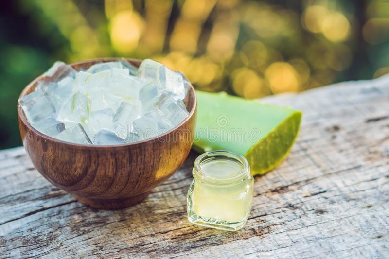 Slices of a aloe vera leaf and a bottle with transparent gel for medicinal purposes, skin treatment and cosmetics, close. Up royalty free stock photos