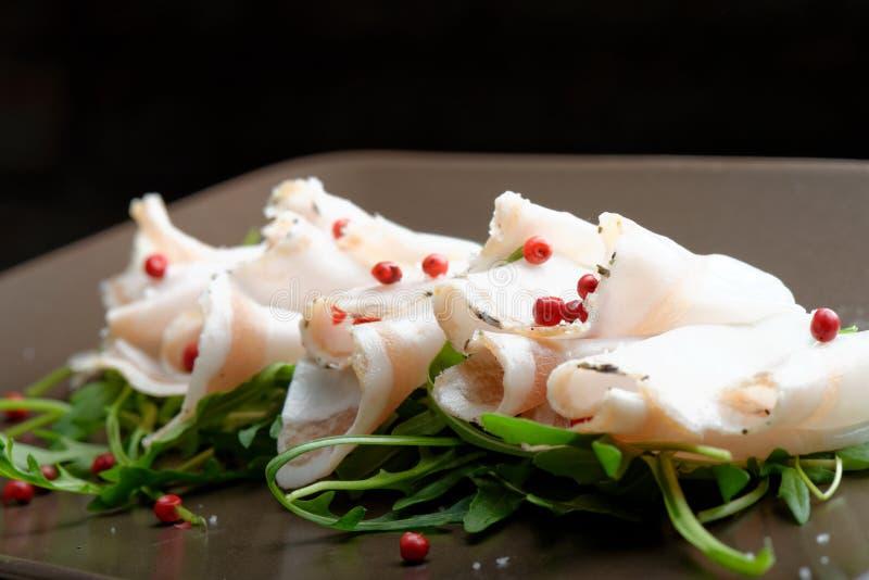 Slices of bacon Lardo di colonnata and pepper stock images