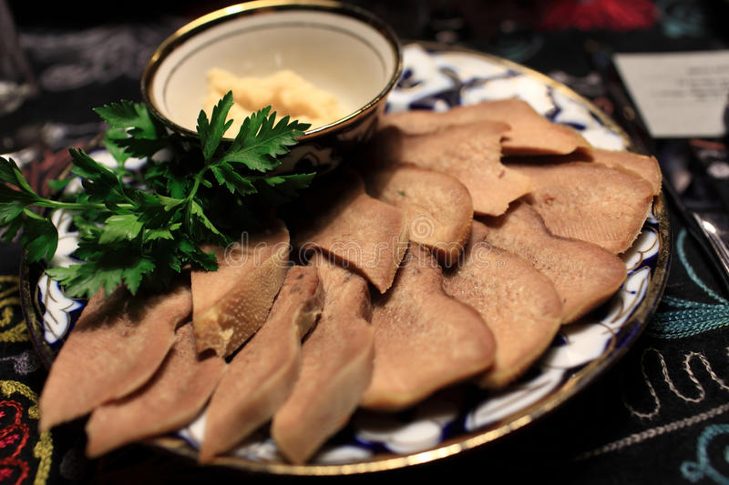 Slices of beef tongue royalty free stock photo