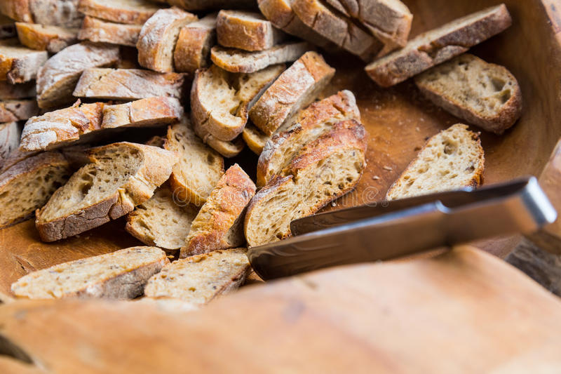 Slices of bread in bowl royalty free stock photography