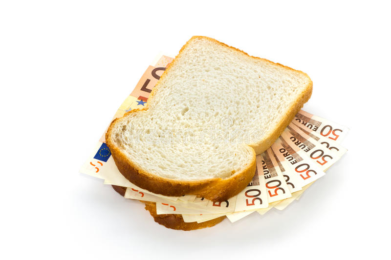 Slices of bread with euro bills sandwich filling royalty free stock photography