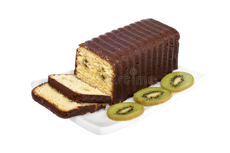 Slices of cake with kiwi. On a dish, reflected over white background. Shallow DOF royalty free stock photography