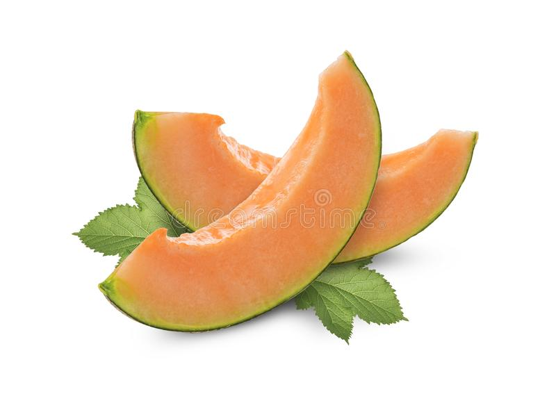 Slices cantaloupe melon with green leaves isolated on white background stock photography