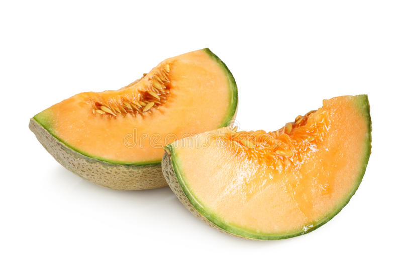 Slices of Cantaloupe melon. On white background stock photography