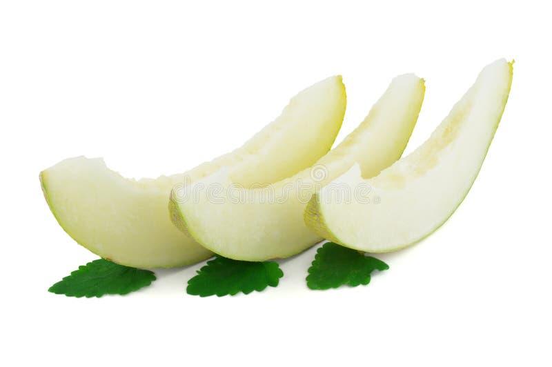 Slices of Cantaloupe melon. On white background stock images