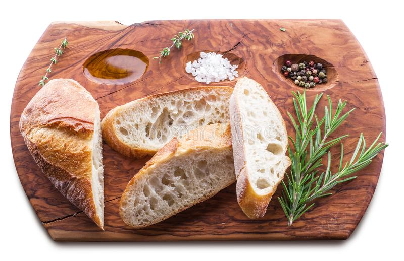 Slices of ciabatta with rosemary herb on the serving wooden tray stock photo