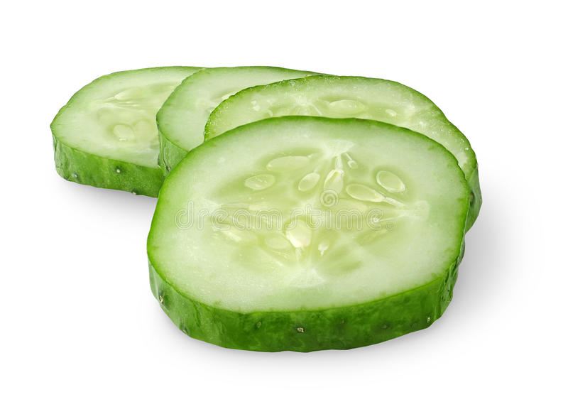 Isolated cucumber slices royalty free stock image