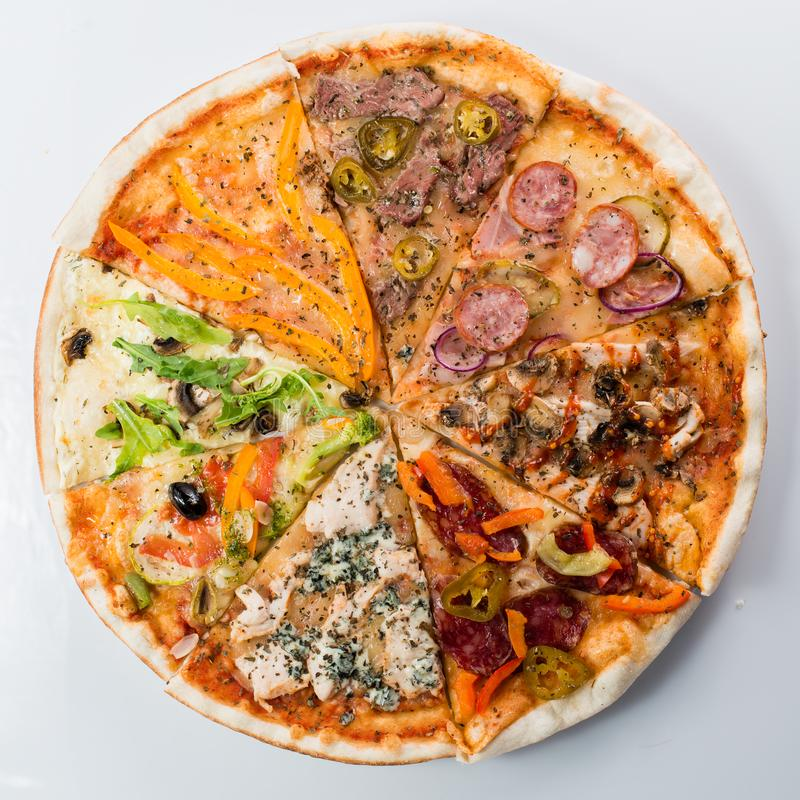 Slices of different pizzas collected in one pizza royalty free stock photo