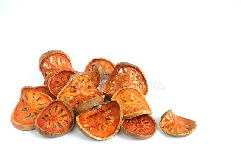 Slices of dried bael fruit on white stock photo