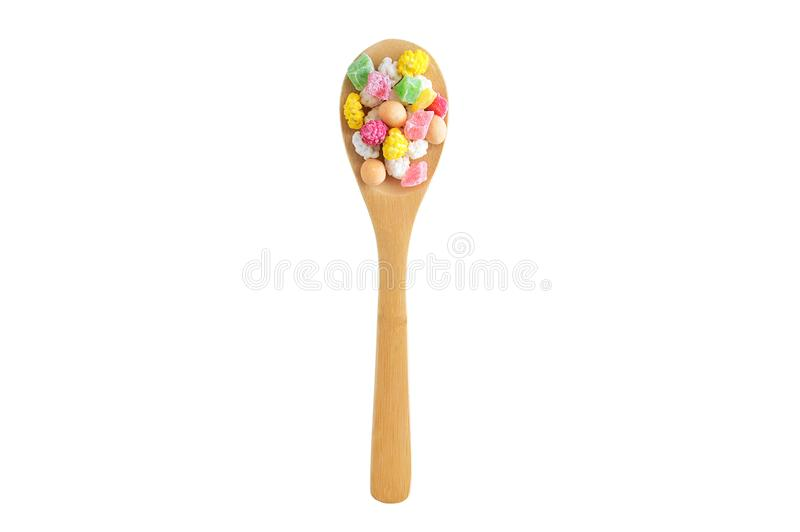 Slices of dried fruit, nuts and candy in the glaze on a wooden spoon. stock photography