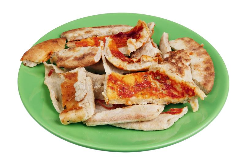 Slices of dried Italian pizza on a green plate isolated stock photography