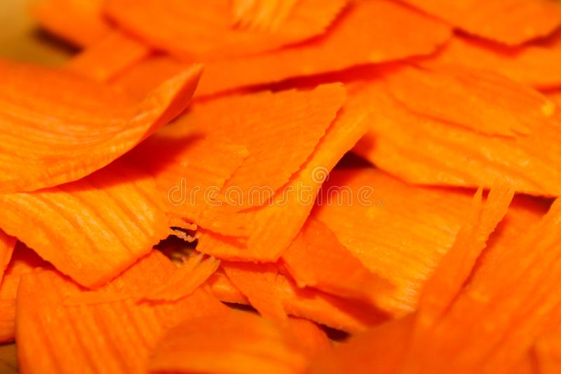 Slices of fresh carrots closeup as background stock photography