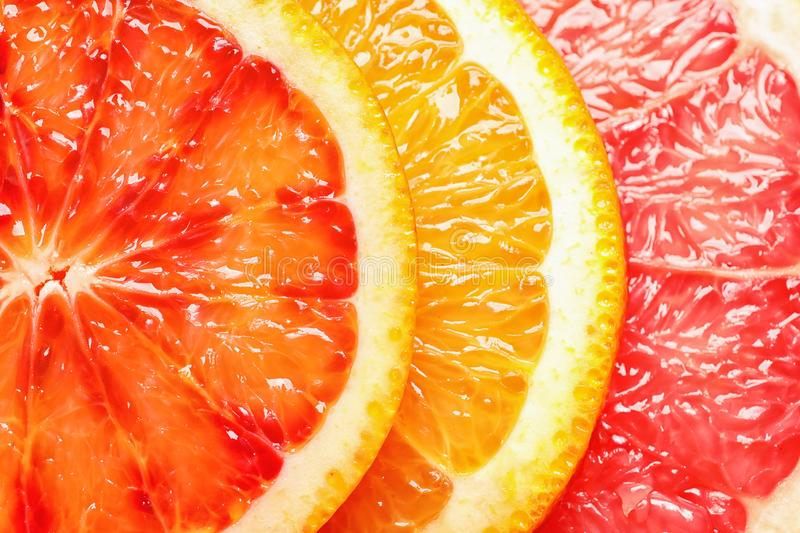 Slices of fresh citrus fruits as background. Top view royalty free stock photography