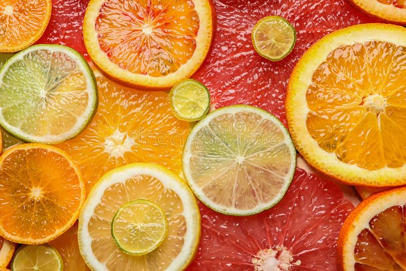 Slices of fresh citrus fruits as background. Top view royalty free stock image