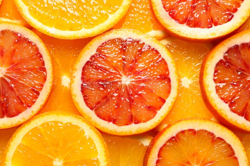 Slices of fresh citrus fruits as background. Top view royalty free stock photos