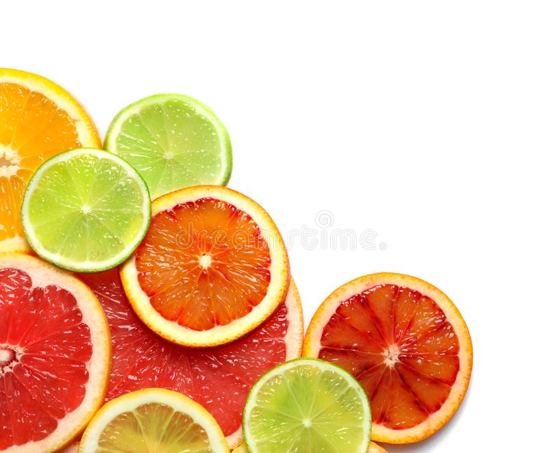 Slices of fresh citrus fruits on white, top view. Slices of fresh citrus fruits on white background, top view royalty free stock photography