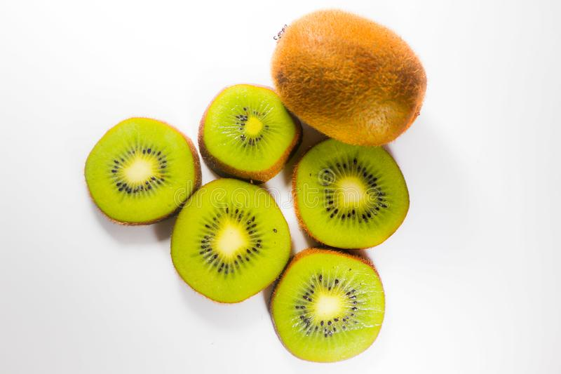 Slices fresh kiwi fruit isolated on white background and wallpaper royalty free stock photos