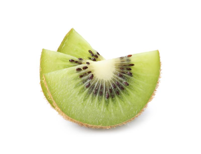 Slices of fresh kiwi on white. Background stock photography