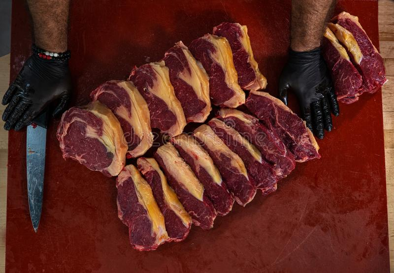Slices of a fresh meat for a steak.  royalty free stock image