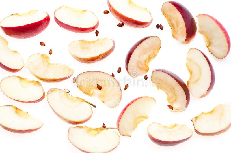 Slices of fresh red apple and seeds, isolated on white background, top view. stock photo