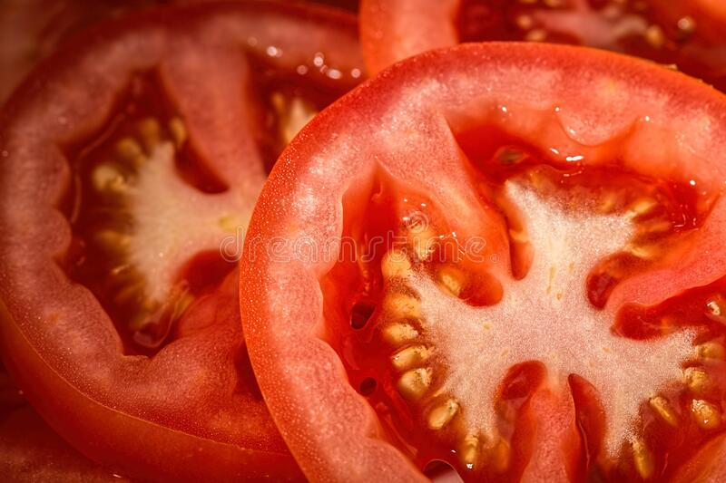 Slices of fresh red tomatoes royalty free stock images