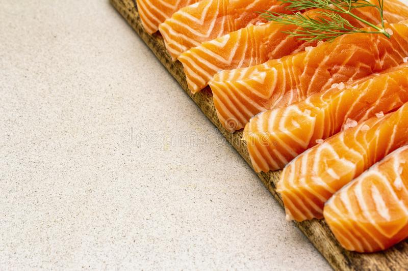 Slices of fresh salmon. Ingredient for cooking healthy seafood. Concept omega 3 containing food royalty free stock photography