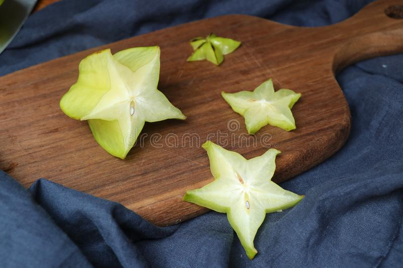 Slices of fresh star fruit. Carambola on a cutting board. royalty free stock photos