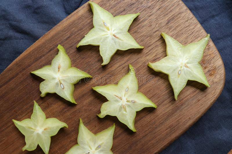 Slices of fresh star fruit. Carambola on a cutting board. stock photo