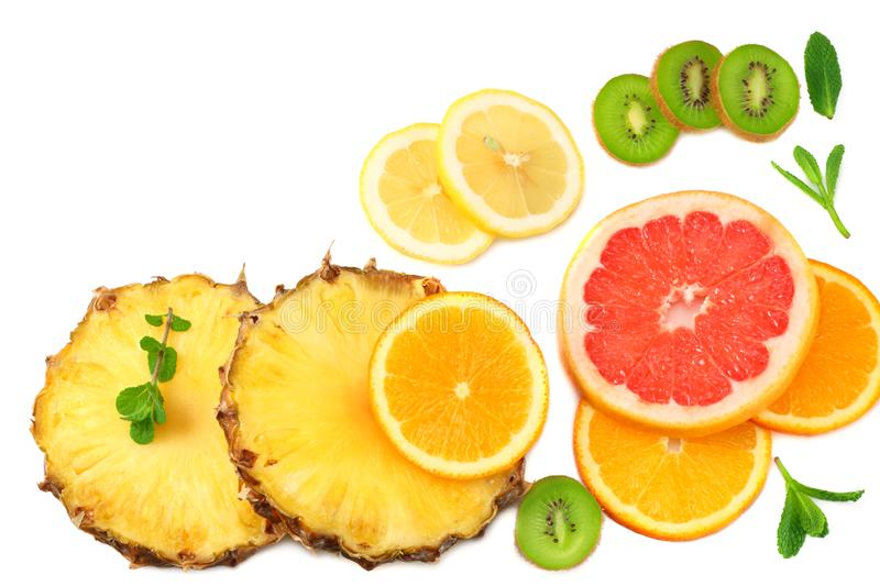 slices of grapefruit, kiwi fruit, orange and pineapple isolated on white background top view healthy background stock photos