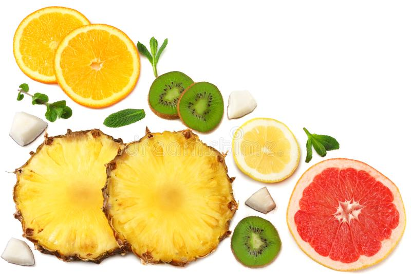 Slices of grapefruit, kiwi fruit, orange and pineapple isolated on white background top view healthy background royalty free stock photo