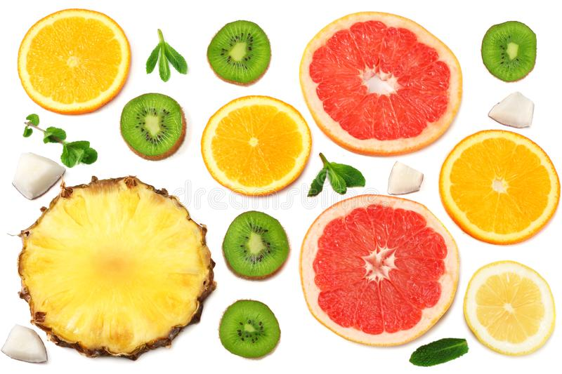 slices of grapefruit, kiwi fruit, orange and pineapple isolated on white background top view healthy background stock images