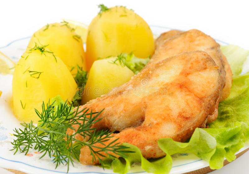 Slices of grilled sea bass. With boiled potatoes stock photo