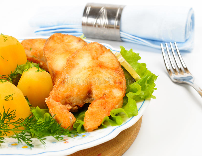 Slices of grilled sea bass. With boiled potatoes stock photography