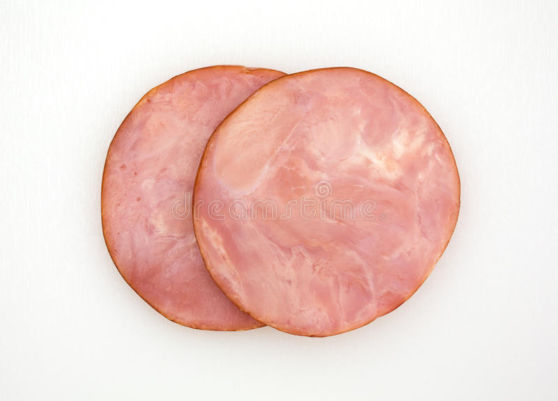 Slices of ham on a cutting board stock image